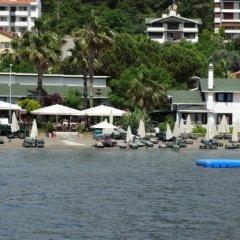 Отель Beachwood Villas пляж