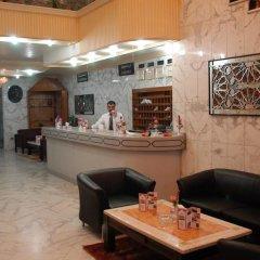 Отель Amman Orchid Hotel Иордания, Амман - отзывы, цены и фото номеров - забронировать отель Amman Orchid Hotel онлайн интерьер отеля фото 3