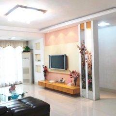 Апартаменты Shenzhen Huijia Apartment комната для гостей фото 2