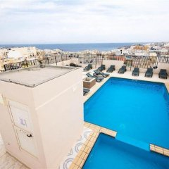 Отель Damiani Мальта, Буджибба - 1 отзыв об отеле, цены и фото номеров - забронировать отель Damiani онлайн бассейн фото 2
