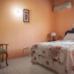 Отель Diamond Villas and Suites Ямайка, Монтего-Бей - отзывы, цены и фото номеров - забронировать отель Diamond Villas and Suites онлайн комната для гостей фото 5