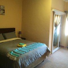 Отель Skyhawk Guesthouse Габороне комната для гостей