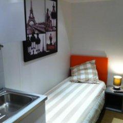 Отель Hôtel & Résidence de la Mare Франция, Париж - отзывы, цены и фото номеров - забронировать отель Hôtel & Résidence de la Mare онлайн комната для гостей фото 6