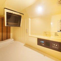 Отель Capsule and Sauna New Century Япония, Токио - отзывы, цены и фото номеров - забронировать отель Capsule and Sauna New Century онлайн удобства в номере фото 2