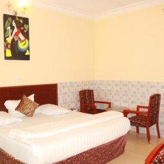 Carlcon Hotel Калабар комната для гостей фото 3