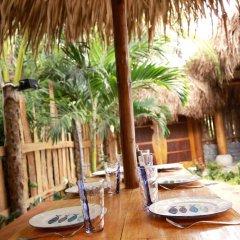 Отель An Bang Sunrise Beach Bungalow питание фото 2