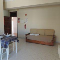 Отель Oura Apartamentos By Garvetur комната для гостей