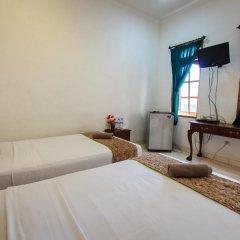 Отель RedDoorz @ Melati Kartika Plaza комната для гостей фото 2