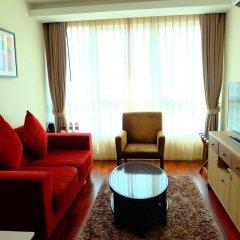 Апартаменты GM Serviced Apartment Бангкок комната для гостей фото 5