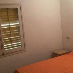 Отель Apartamentos Calafats Испания, Льорет-де-Мар - отзывы, цены и фото номеров - забронировать отель Apartamentos Calafats онлайн комната для гостей фото 4