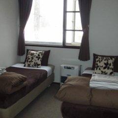 Отель Hakuba Powder Lodge Хакуба комната для гостей