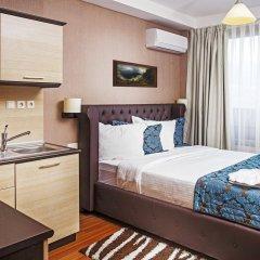 Regnum Apartment Hotel в номере фото 2