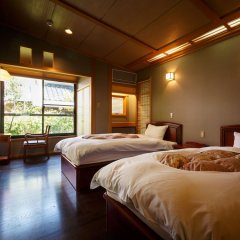 Отель Yufuin Ryokan Baien Хидзи сейф в номере