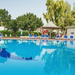Отель Holiday International Sharjah ОАЭ, Шарджа - 5 отзывов об отеле, цены и фото номеров - забронировать отель Holiday International Sharjah онлайн бассейн фото 3