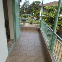 Отель Holiday Lodge Сьерра-Леоне, Фритаун - отзывы, цены и фото номеров - забронировать отель Holiday Lodge онлайн балкон