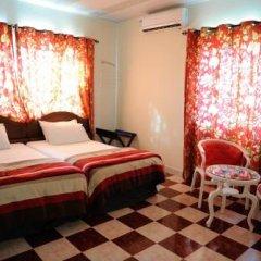 Отель Mount Pleasant Inns & Apartments Гана, Кофоридуа - отзывы, цены и фото номеров - забронировать отель Mount Pleasant Inns & Apartments онлайн комната для гостей фото 3