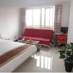 Отель Xi'an Haojia Apartment Китай, Сиань - отзывы, цены и фото номеров - забронировать отель Xi'an Haojia Apartment онлайн комната для гостей фото 3