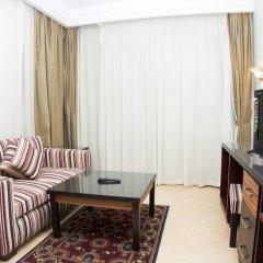 Апартаменты Pyramisa Sunset Pearl Apartments комната для гостей фото 4