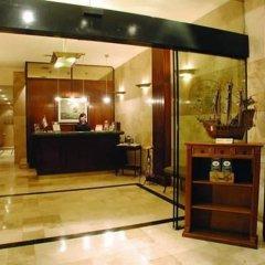 Отель Mayflower Suites интерьер отеля