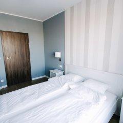 Отель Renttner Apartamenty Польша, Варшава - отзывы, цены и фото номеров - забронировать отель Renttner Apartamenty онлайн комната для гостей фото 5