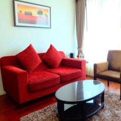 Апартаменты GM Serviced Apartment Бангкок комната для гостей фото 4