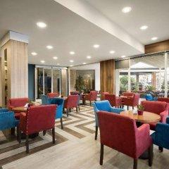 Ramada by Wyndham Mersin Турция, Мерсин - отзывы, цены и фото номеров - забронировать отель Ramada by Wyndham Mersin онлайн гостиничный бар