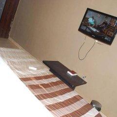 Отель Emglo Suites удобства в номере фото 2