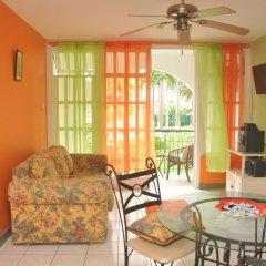 Апартаменты Palm View Apartment At Sandcastles комната для гостей фото 5