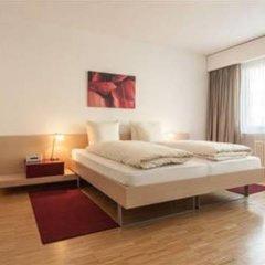 Апартаменты EMA house Serviced Apartments, Unterstrass Цюрих комната для гостей