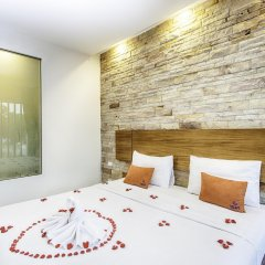 Escape De Phuket Hotel & Villa комната для гостей