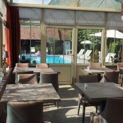 Отель Charmehotel Het Bloemenhof Бельгия, Брюгге - отзывы, цены и фото номеров - забронировать отель Charmehotel Het Bloemenhof онлайн интерьер отеля фото 2