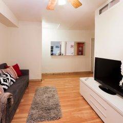 Отель NY071 2 Bedroom Apartment By Senstay США, Нью-Йорк - отзывы, цены и фото номеров - забронировать отель NY071 2 Bedroom Apartment By Senstay онлайн комната для гостей фото 2