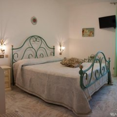 Отель Villa Conca Smeraldo Конка деи Марини комната для гостей фото 4