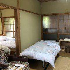 Отель NISHINOKUBO Япония, Минамиогуни - отзывы, цены и фото номеров - забронировать отель NISHINOKUBO онлайн комната для гостей