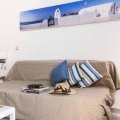 Апартаменты Ammades Epsilon Apartments комната для гостей фото 2