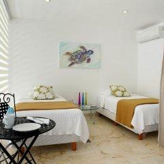 Отель Costa Fina Oceanview Penthouse Мексика, Плая-дель-Кармен - отзывы, цены и фото номеров - забронировать отель Costa Fina Oceanview Penthouse онлайн комната для гостей