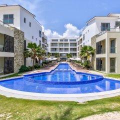 Отель Costa Atlantica Beach Condos Доминикана, Пунта Кана - отзывы, цены и фото номеров - забронировать отель Costa Atlantica Beach Condos онлайн бассейн фото 2