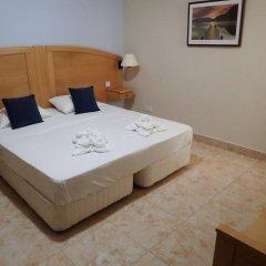 Отель Aparthotel Ulysses Мунксар комната для гостей фото 5
