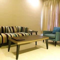 Отель Golden Tulip Essential Benin City комната для гостей