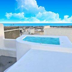 Отель The Luna Suites Греция, Остров Санторини - отзывы, цены и фото номеров - забронировать отель The Luna Suites онлайн бассейн фото 3