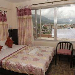 Отель Center lake Непал, Покхара - отзывы, цены и фото номеров - забронировать отель Center lake онлайн комната для гостей фото 4