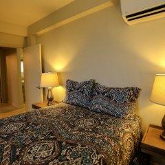 Отель Perez Ipao Apartments США, Тамунинг - отзывы, цены и фото номеров - забронировать отель Perez Ipao Apartments онлайн удобства в номере