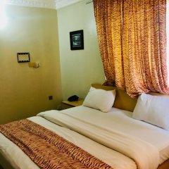 Mignonette Hotel & Suites комната для гостей фото 4