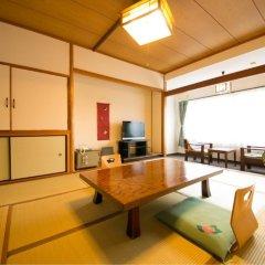 Отель Kinosato Yamanoyu Япония, Минамиогуни - отзывы, цены и фото номеров - забронировать отель Kinosato Yamanoyu онлайн комната для гостей