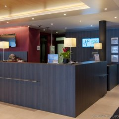 Отель Holiday Inn Express Zurich Airport Швейцария, Рюмланг - 1 отзыв об отеле, цены и фото номеров - забронировать отель Holiday Inn Express Zurich Airport онлайн интерьер отеля