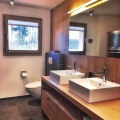 Апартаменты Gstaad Perfect Winter Luxury Apartment ванная фото 2