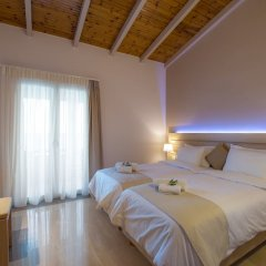 Апартаменты Krouzeri Beach Apartments комната для гостей фото 5