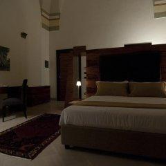 Отель Alvino Suite & Breakfast Лечче сейф в номере