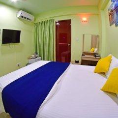 Отель Tourist Inn Мале комната для гостей фото 2