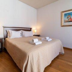 Апартаменты Chiado Apartments Лиссабон комната для гостей фото 5